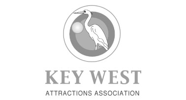 Logo for the Key West Attractions Assciation that features an egret imposed against several circles of different sizes