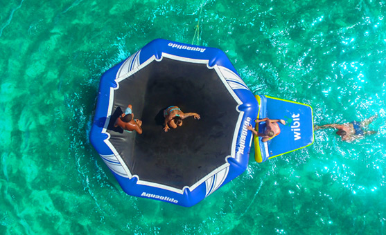 Overhead view of people jumping on a floating trampoline in a Fury water adventure