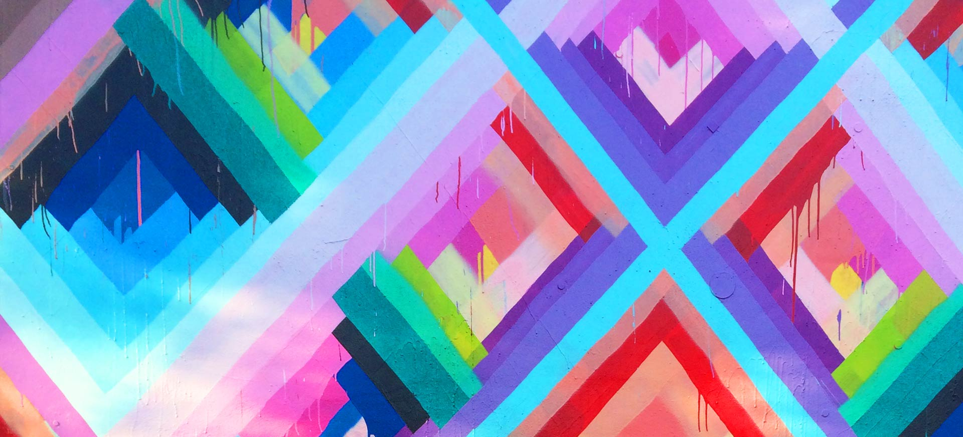 An extreme close-up of a mural from Miami's Wynwood district that displays multi-colored diamond shapes
