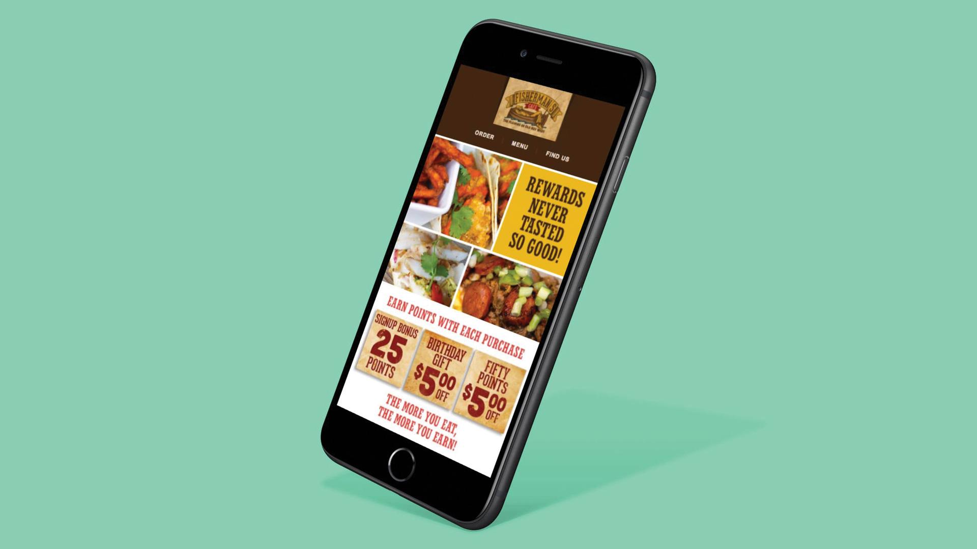 Phone displaying Fisherman's Cafe website
