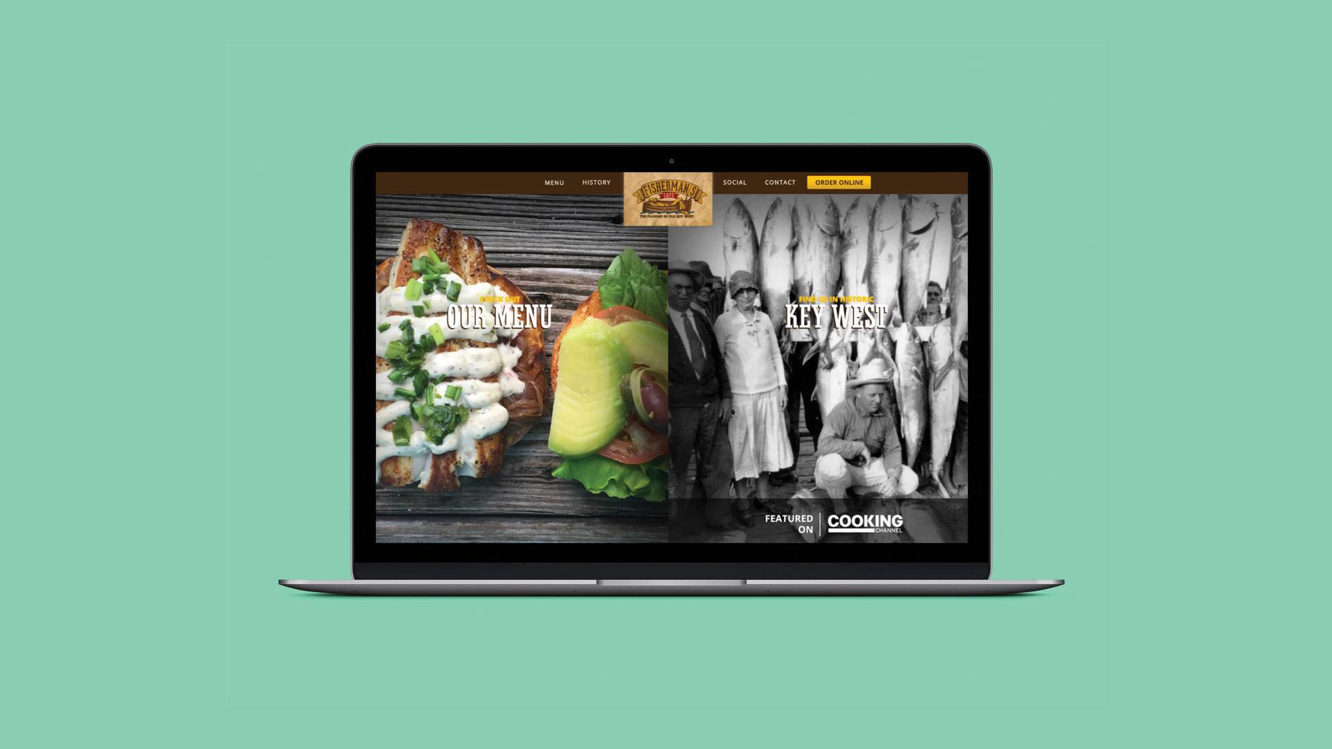 Laptop displaying Fisherman's Cafe website