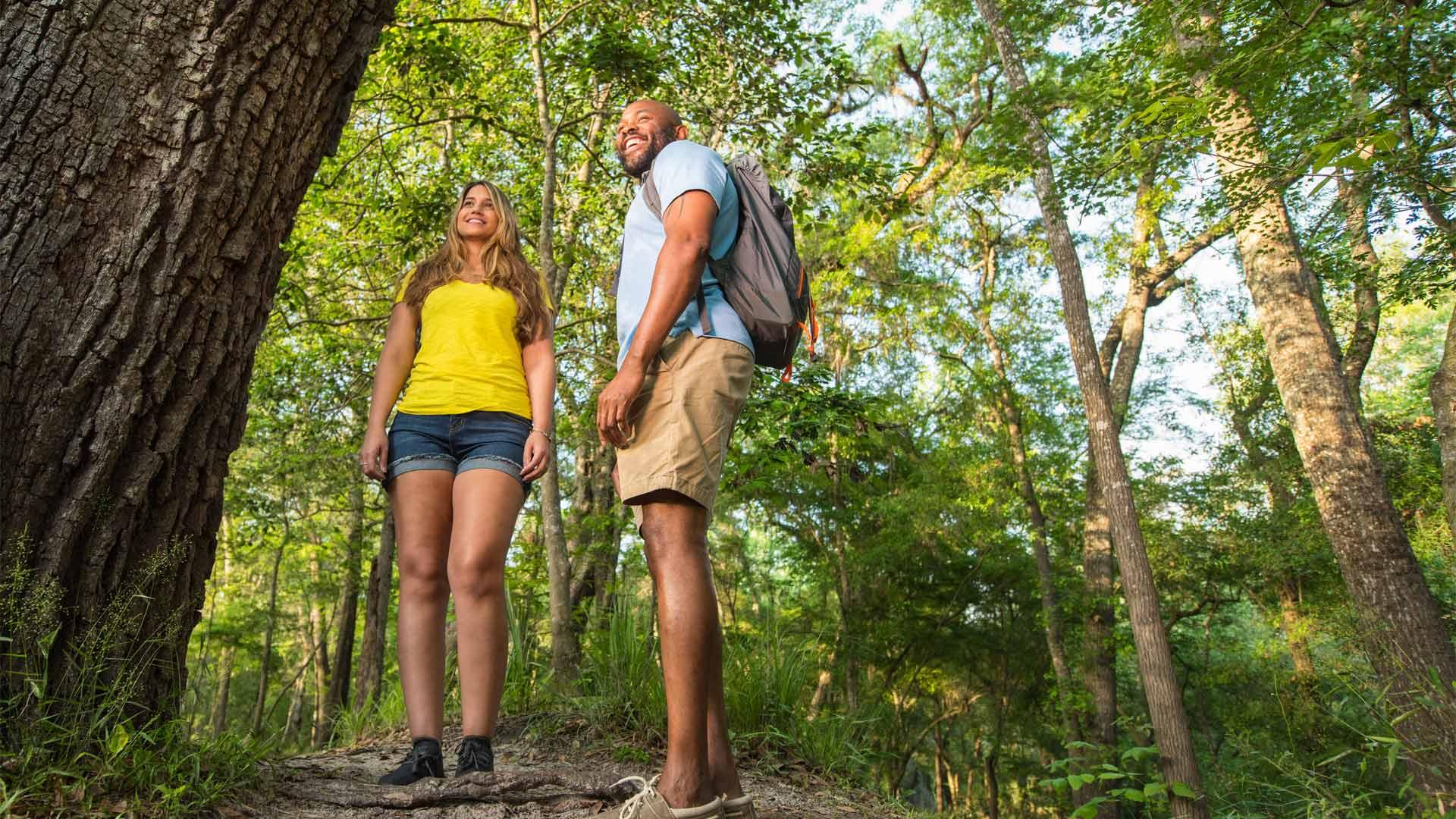 Couple smile while hiking