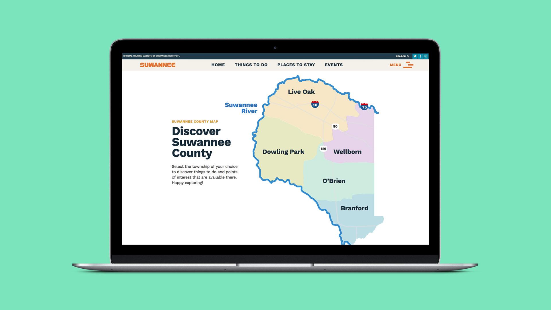 Laptop displaying Suwannee County website map