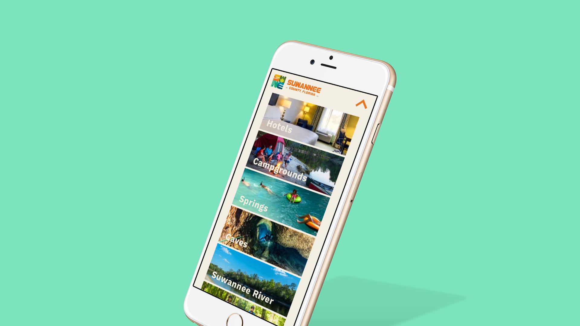 Phone displaying Suwannee County website