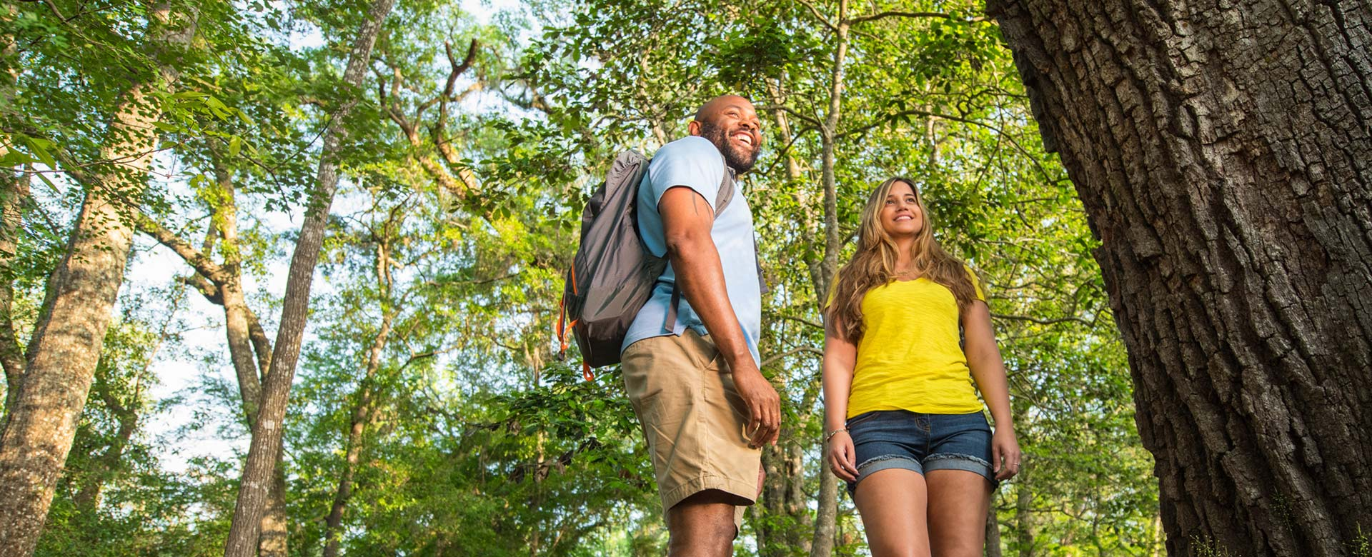 Couple smiling while hiking