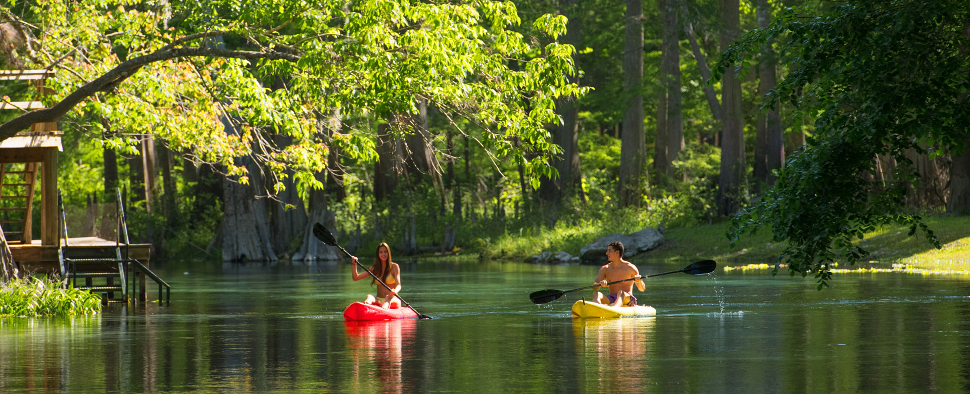 Young couple kayaking at daytime in Suwannee County river
