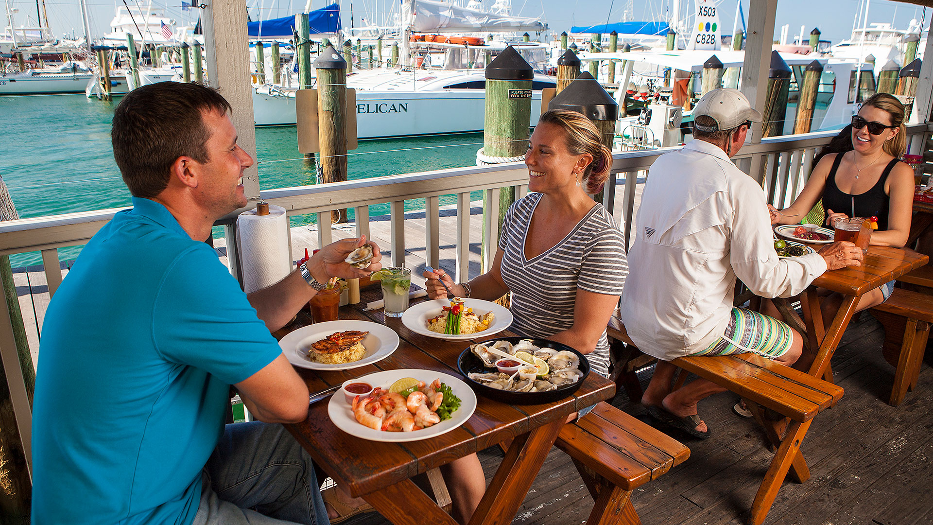 picture of couple dining outdoors with view of the water at half shell raw bar