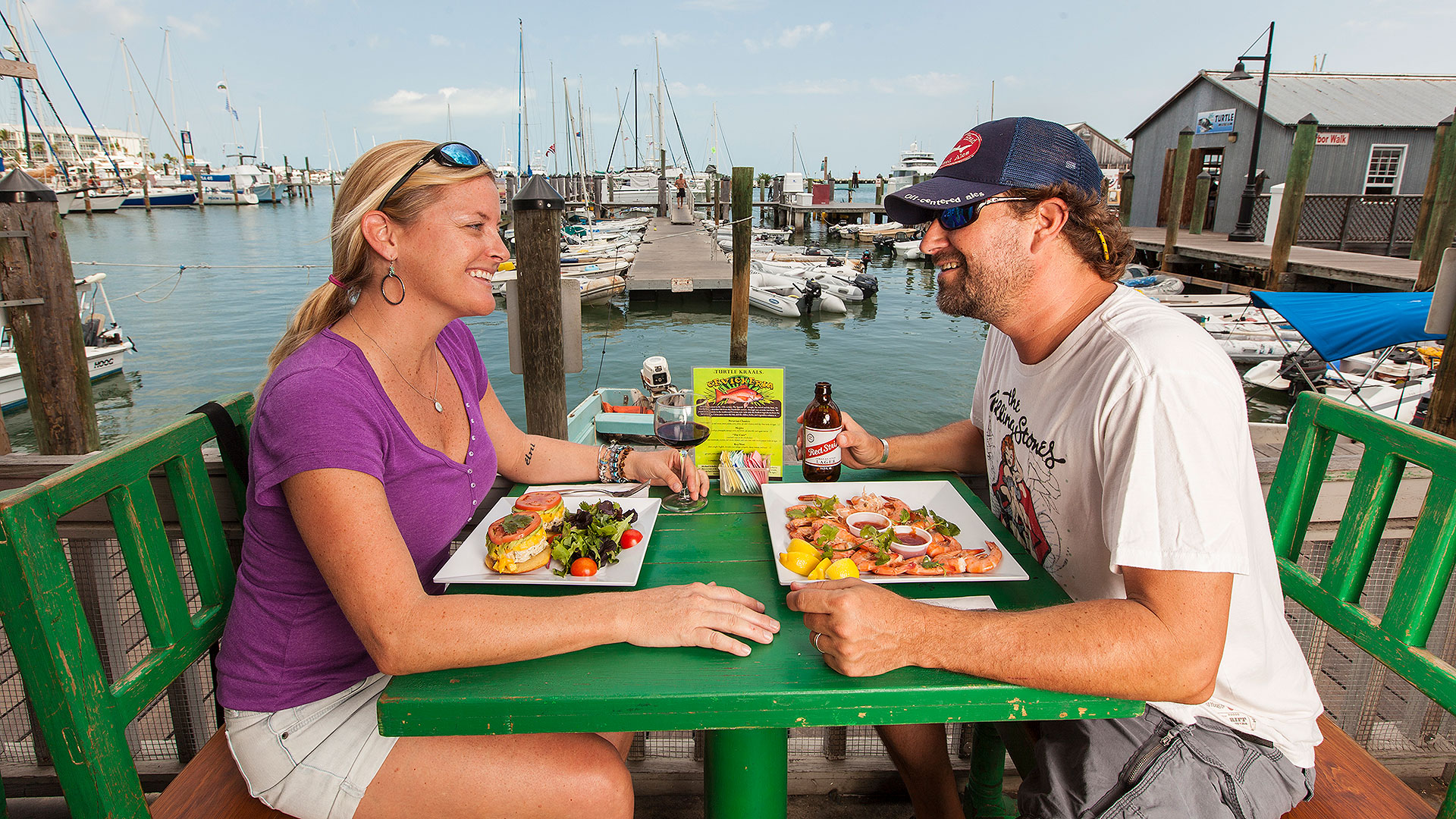 picture of couple dining outdoors with view of water at turtle kraals restaurant