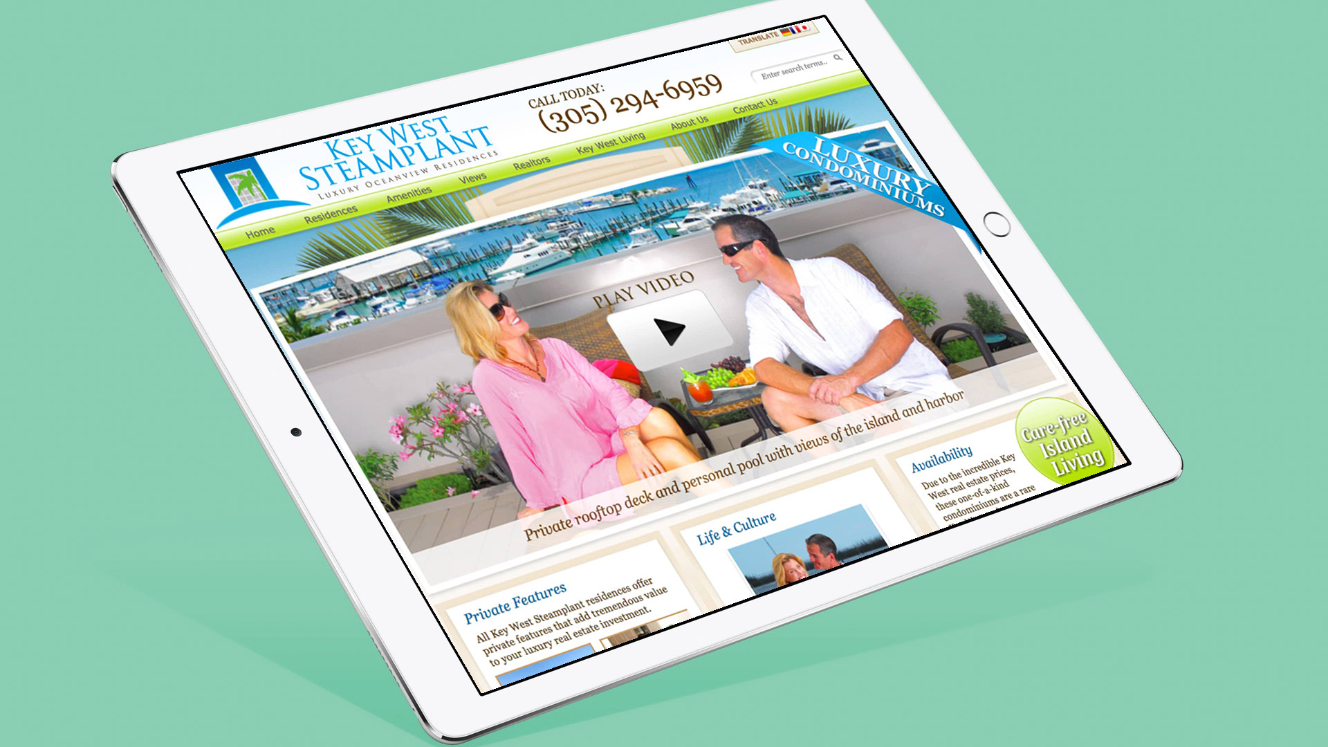 tablet showing key west steamplant web home page featuring logo and phone number at top and main picture of a couple on roof top deck with key west harbor in background