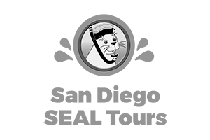 logo with a seal illustration inside a circle wearing a mask and snorkel, water drops and the words 'San Diego SEAL Tours'